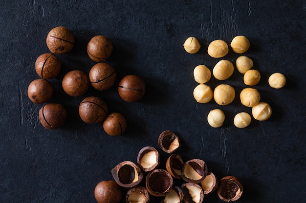 Top view of texture of fresh natural unshelled raw macadamia nuts Premium Photo