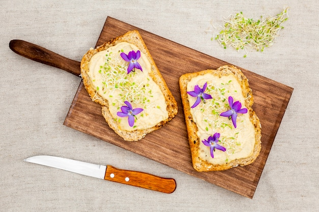 Top view of toast with flowers on chopping board Free Photo