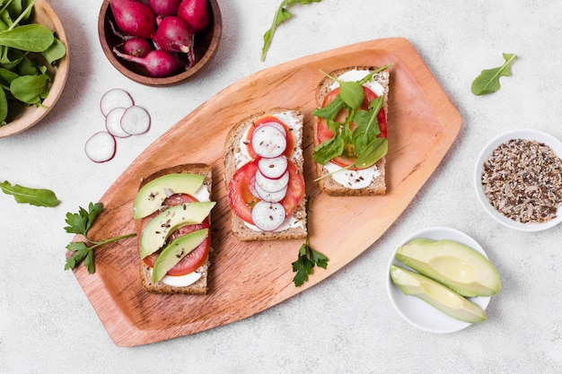 Top view of toast with variety of vegetables Free Photo