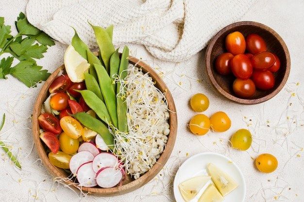 Top view of tomatoes in bowl with healthy food Free Photo