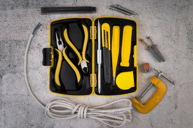 Top view toolbox with yellow tools Free Photo