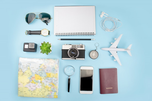 Top view of tourist accessories with film cameras, maps, passports, watches, compasses Premium Photo