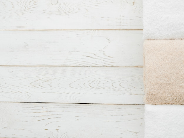 Top view towels on wooden background with copyspace Free Photo