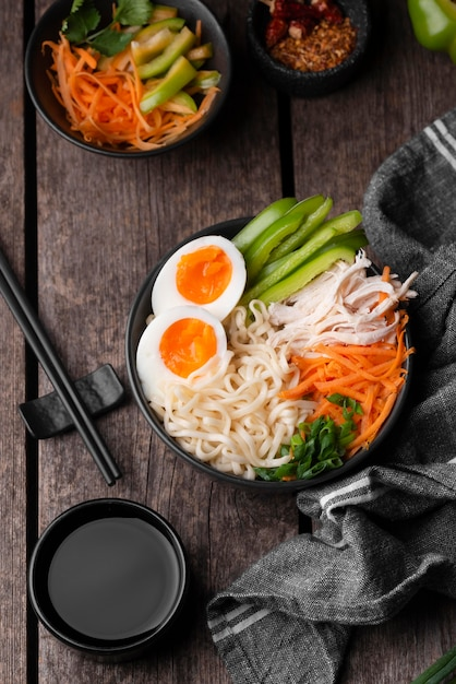 Top view of traditional asian noodles with eggs and chopsticks Free Photo