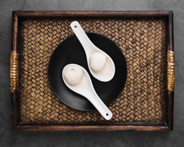 Top view of tray with dumplings in spoons Free Photo