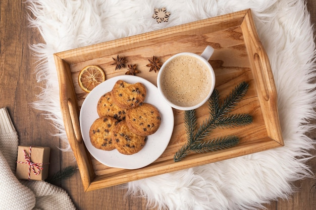 Top view of tray with plate of cookies and cup of hot cocoa Free Photo
