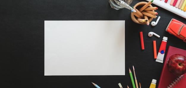 Top view of trendy artist studio with sketch paper and painting tools Premium Photo