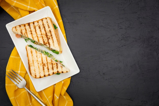 Top view of triangular sandwiches with copy space Premium Photo