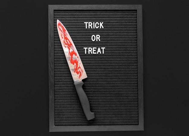 Top view trick or treat with knife Free Photo