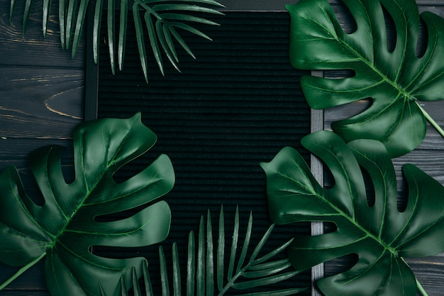 Premium Photo Top View Tropical Leaves And Board With Copyspace On A Dark Background Similar banana leaf outline background images. https www freepik com profile preagreement getstarted 2599274