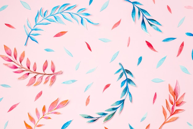 Top view tropical leaves on pink background Premium Photo