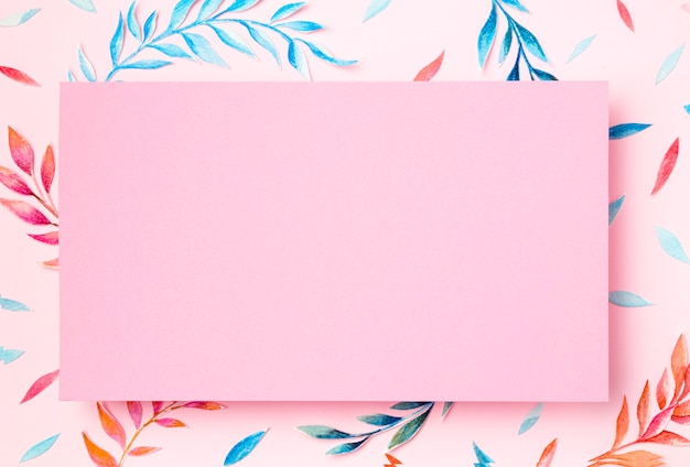Top view tropical leaves on pink background Free Photo