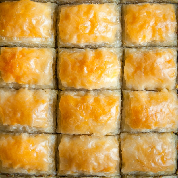 Top view turkish baklava dessert made of thin pastry, nuts and honey Free Photo
