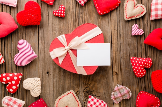Top view of valentines day ornaments with gift Free Photo