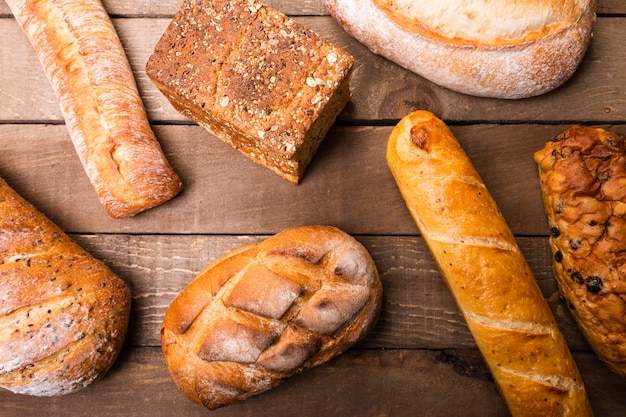 Top view variety of delicious breads on the table Free Photo