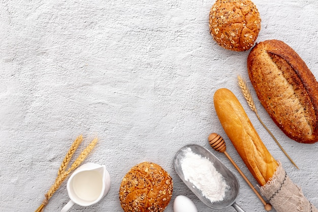 Top view variety of fresh baked bread and copy space Free Photo
