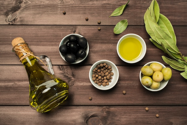 Top view variety of olive oil and olives Free Photo
