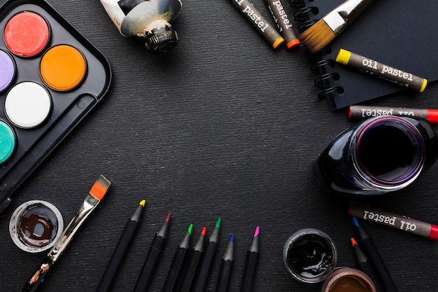 Co-curricular activities-Top view various brushes and crayons