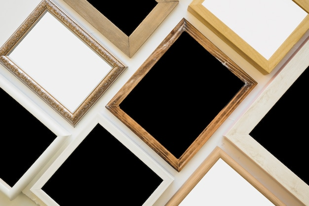 Top view of various picture frame on background Free Photo