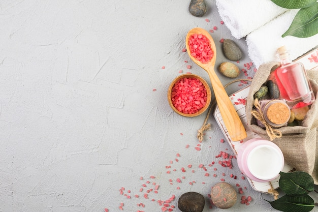 Top view of various spa products on grey background Free Photo