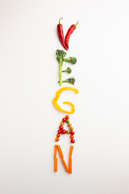 Top view vegan lettering made out of vegetables Free Photo