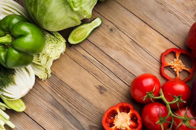 Top view vegetables assortment on wooden background with copy space Free Photo