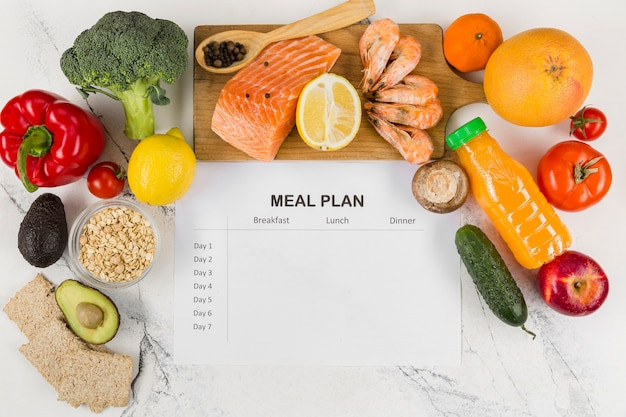 Top view of vegetables and salmon with plan Premium Photo