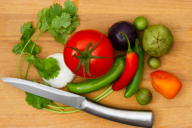 Top view vegetables with wooden background Free Photo
