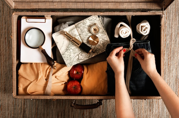 Top view vintage suitcase with casual clothes Free Photo