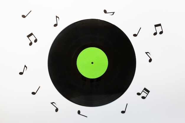 Top view vinyl disc with musical notes Premium Photo
