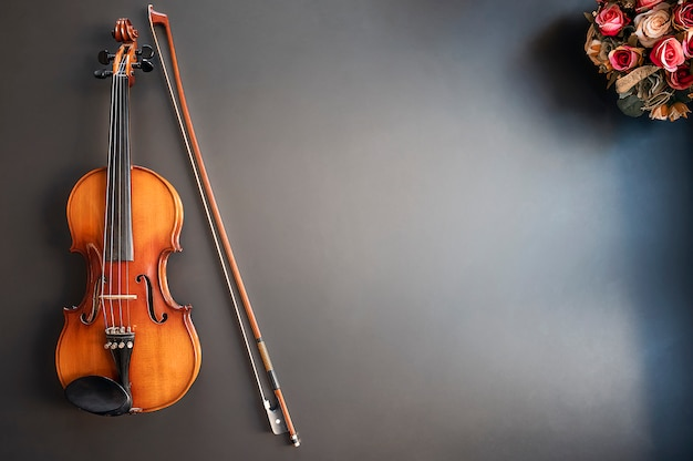 Top view of violin musical on blue background with copy space. Premium Photo