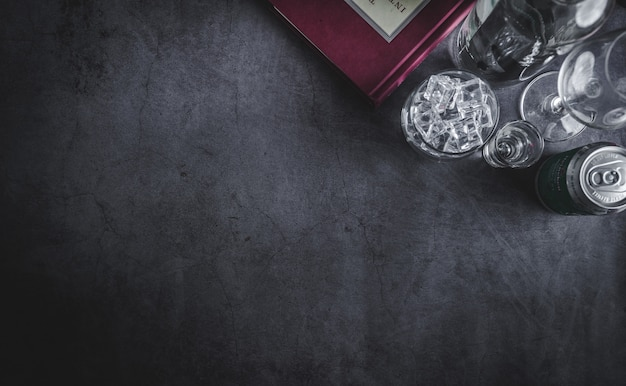 Top view of  vodka bottle, ice cube and beer Premium Photo