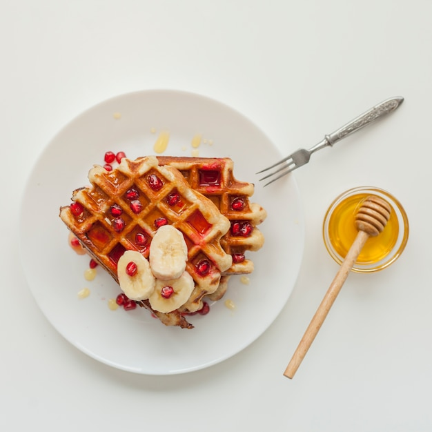 Top view waffle with honey and fork Free Photo