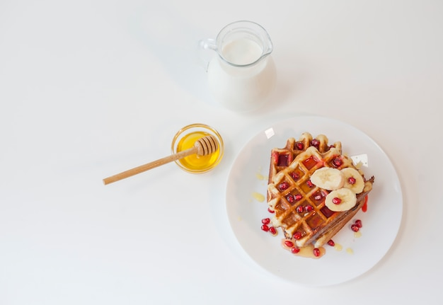 Top view waffle with honey and milk Free Photo