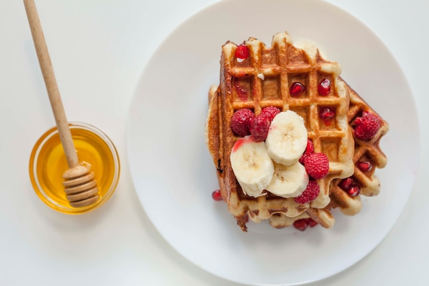 Top view waffle with honey Free Photo