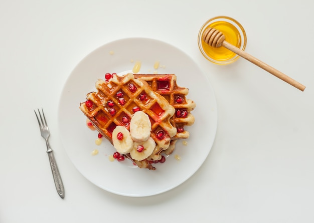 Top view waffle with honey Premium Photo