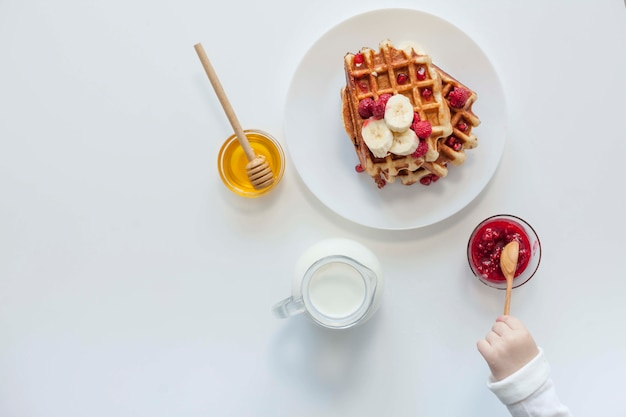 Top view waffle with jam,milk and honey Free Photo