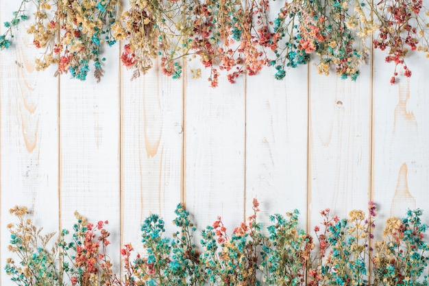 Top view of wedding flowers on white wood background Premium Photo