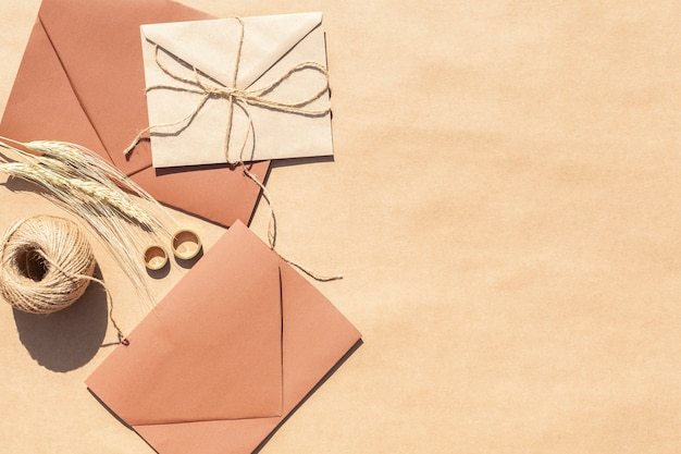 Top view wedding invitations in envelopes with copy space Free Photo