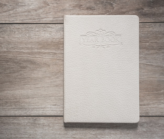 Top view of white book on old wooden plank background Premium Photo