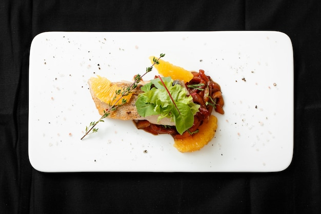 Top view of white fish fillet with vegetable stew Premium Photo