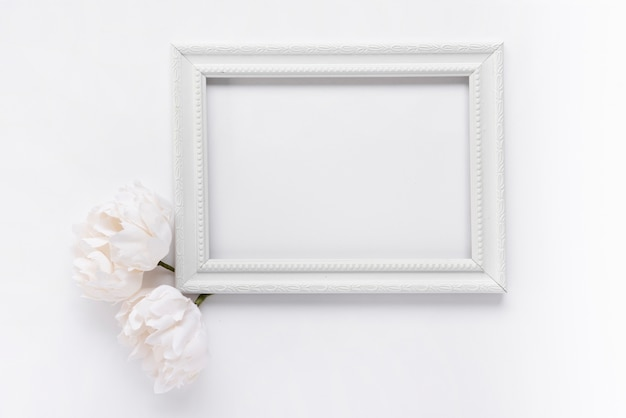 Top view white frame with flowers Premium Photo