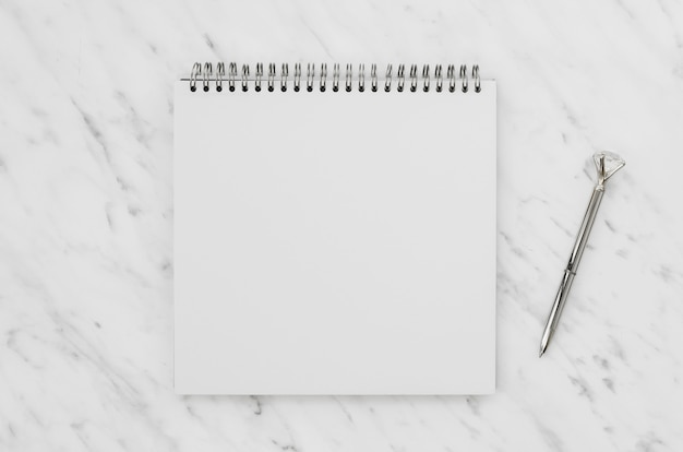 Top view of white notebook on marble desk Free Photo