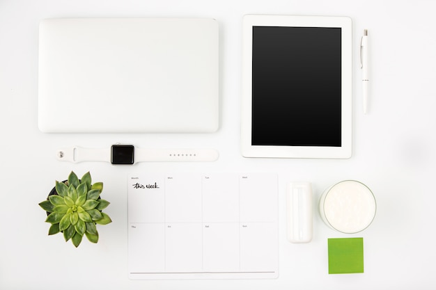 Top view of white office table with laptop Free Photo