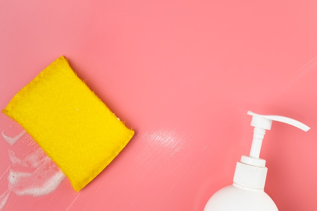 Top view white soap bottle and sponge Free Photo