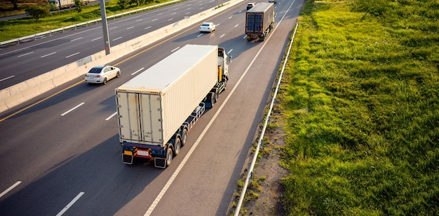 Top view of white truck motion blur on highway road with container, transportation concept. Premium Photo