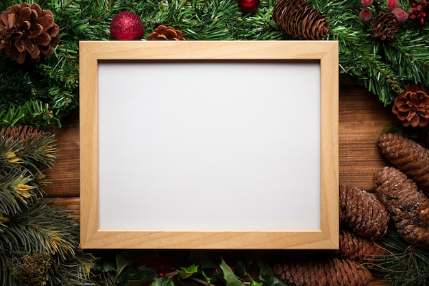 Top view whiteboard with christmas decoration Free Photo