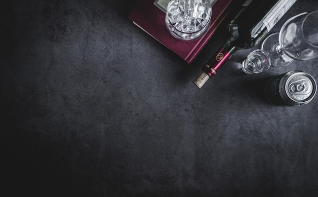 Top view of wine bottle, vodka bottle, ice cube and beer Premium Photo