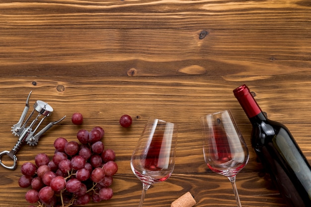 Top view wine bottle with glass on wooden background Free Photo