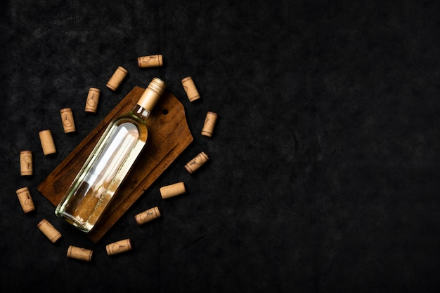 Top view wine bottle with slate background Free Photo